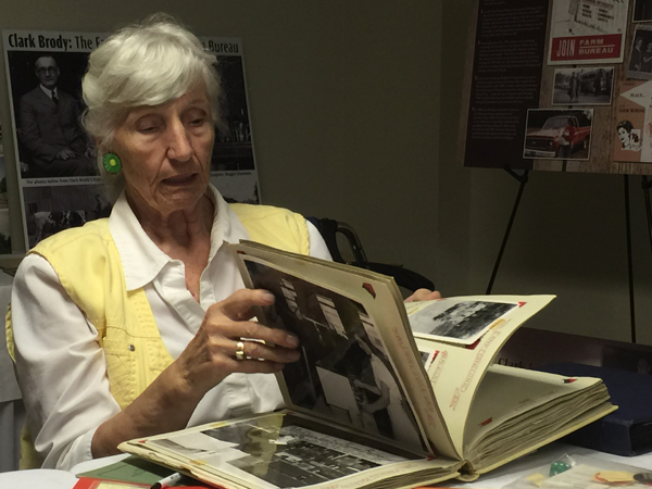 Barry County's Betty Thalmann peruses her own handiwork -- a Junior Farm Bureau scrapbook from the mid-1950s.